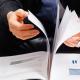 businessman_reading_report_header